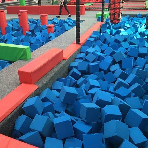 Blue foam trampoline park agility course foam pit feature