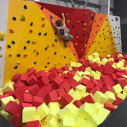 Red yellow foam trampoline park agility course foam pit feature climbing wall