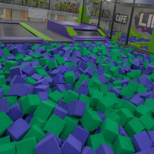 Green purple foam trampoline park agility course foam pit feature