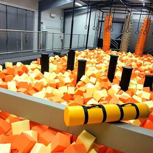 Orange foam trampoline park agility course foam pit feature balance beam battle